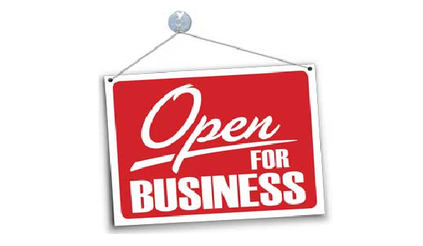 """Banner showing sign with text that reads """"Open for Business"""""""