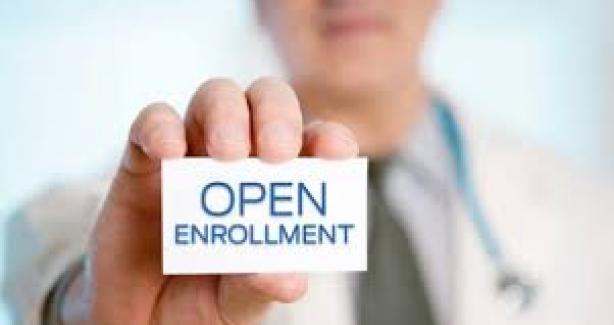 Health Benefits Open Enrollment image of doctor's hand holding card