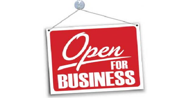 "Banner showing sign with text that reads ""Open for Business"""